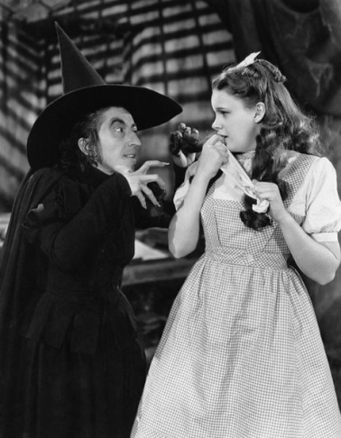 American entertainers Margaret Hamilton as the Wicked Witch of the West (left) and Judy Garland as Dorothy Gale (right) in the 1939 MGM feature film The Wizard of Oz.