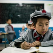 "This photo taken on November 7, 2016 shows students studying in their classroom at the Yang Dezhi ""Red Army"" elementary school in Wenshui, Xishui country in Guizhou province."