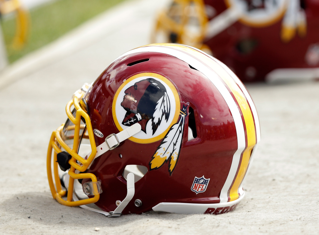 Washington Redskins helmets lay on the ground during their game against the Oakland Raiders at O.co Coliseum on September 29, 2013 in Oakland, California.