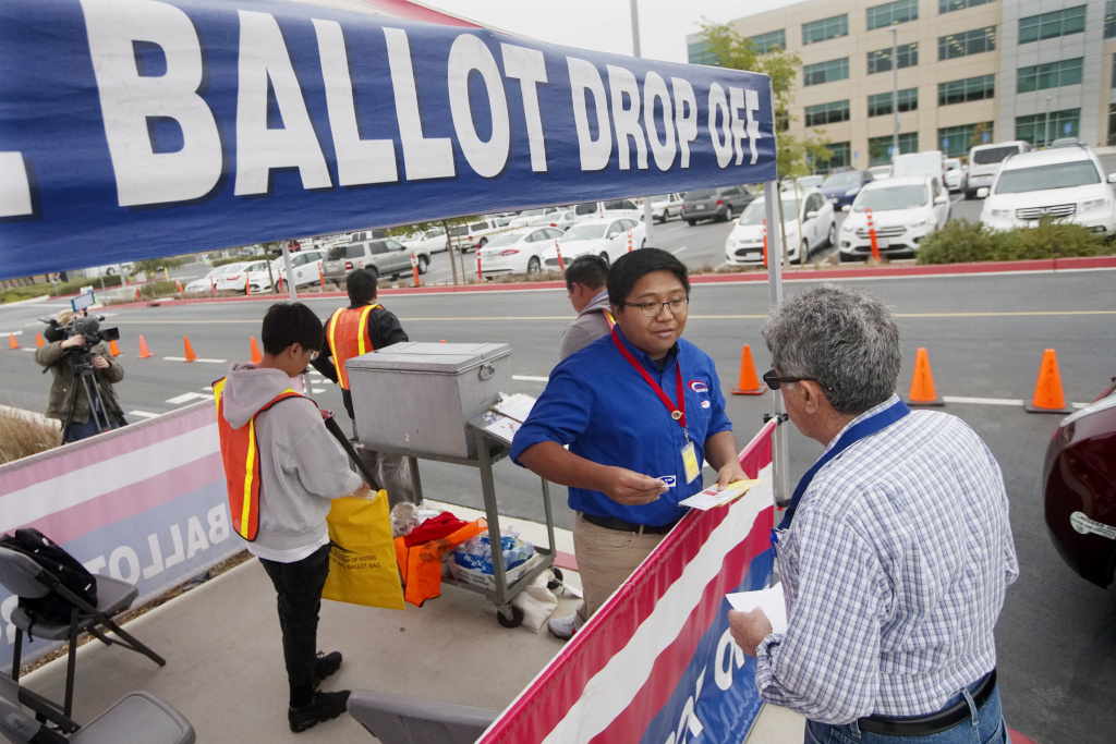 Motorists drop off their ballots at the Registrar of Voters on primary election day June 5, 2018 in San Diego. Eight states, including California, hold primary elections on Tuesday and there are several highly competitive races, including those for governor and U.S. House and Senate seats.
