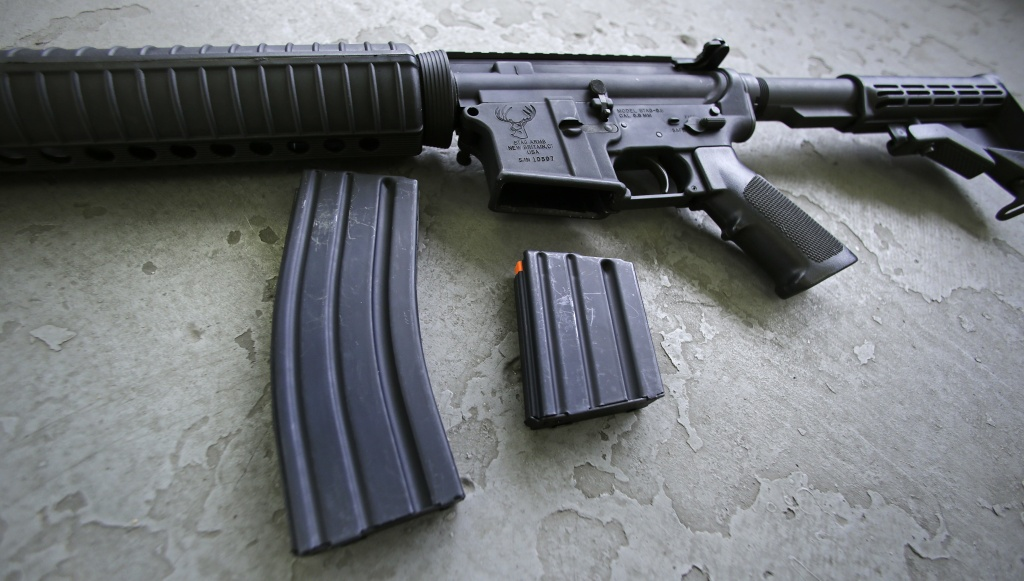 A 30 round magazine, left, and a 10 round magazine, right, rest below an AR-15 rifle, similar to the weapon lost by an Orange County Sheriff's deputy Tuesday.