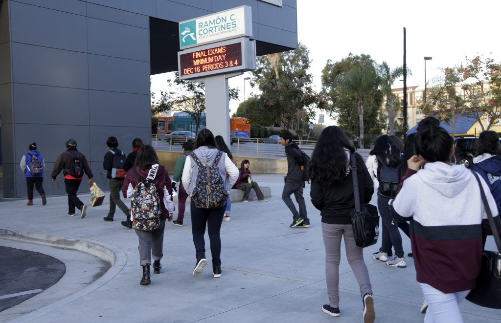 Students arrive at the Ramon C. Cortines School of Visual and Performing Arts in downtown Los Angeles on Wednesday, Dec. 16, 2015. Students are heading back to class a day after an emailed threat triggered a shutdown of the vast Los Angeles Unified School District.