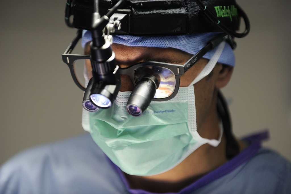 A surgeon wears a binocular loupe during an open-heart surgery in a cardiac surgery unit at the Angers hospital in Angers, western France, on October 24, 2013. The Angers hospital employs 6,000 people including 980 doctors.