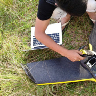 Researchers download images after a drone flight in Sabah, Malaysia.