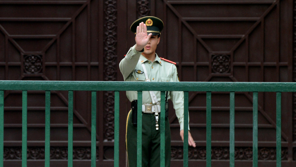 A Chinese paramilitary guard gestures outside the North Korean Embassy in Beijing on May 17.