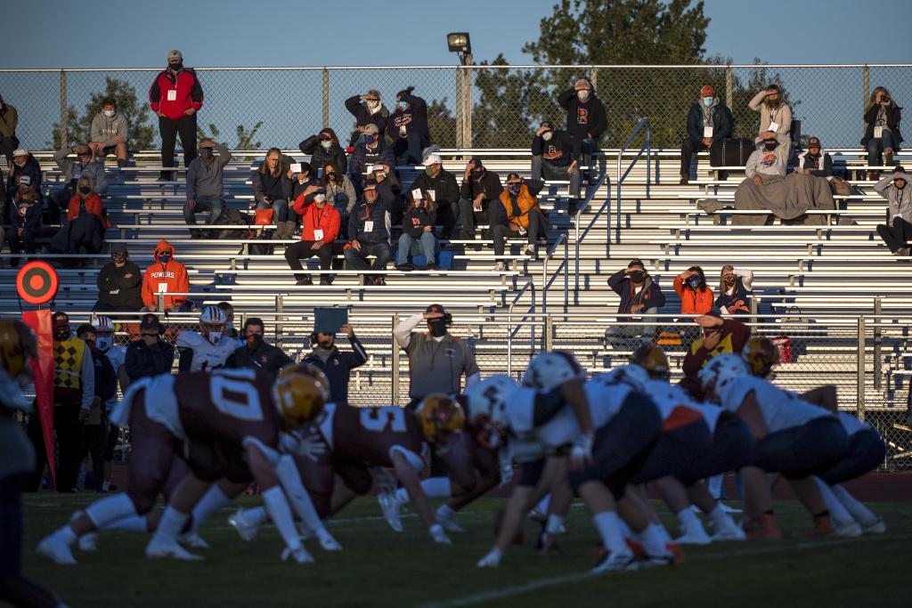 Fans watch the high school football game between Davison and Flint Powers Catholic on September 18, 2020 in Davison, Michigan.