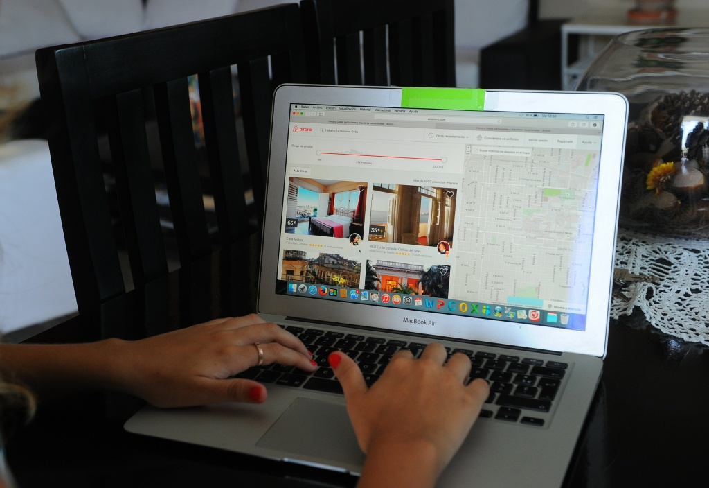 A Cuban woman provides a reservation service from a laptop in a rental house in Havana, on July 10, 2015.