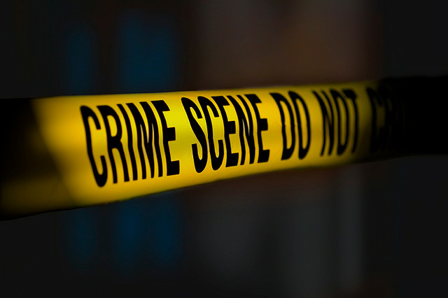 Photo illustration of crime scene yellow tape