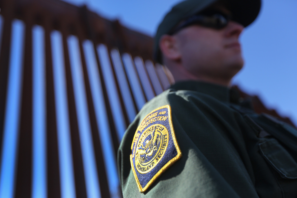 A U.S. Border Patrol agent stands at the U.S.-Mexico border fence on February 26, 2013 in Nogales, Arizona.