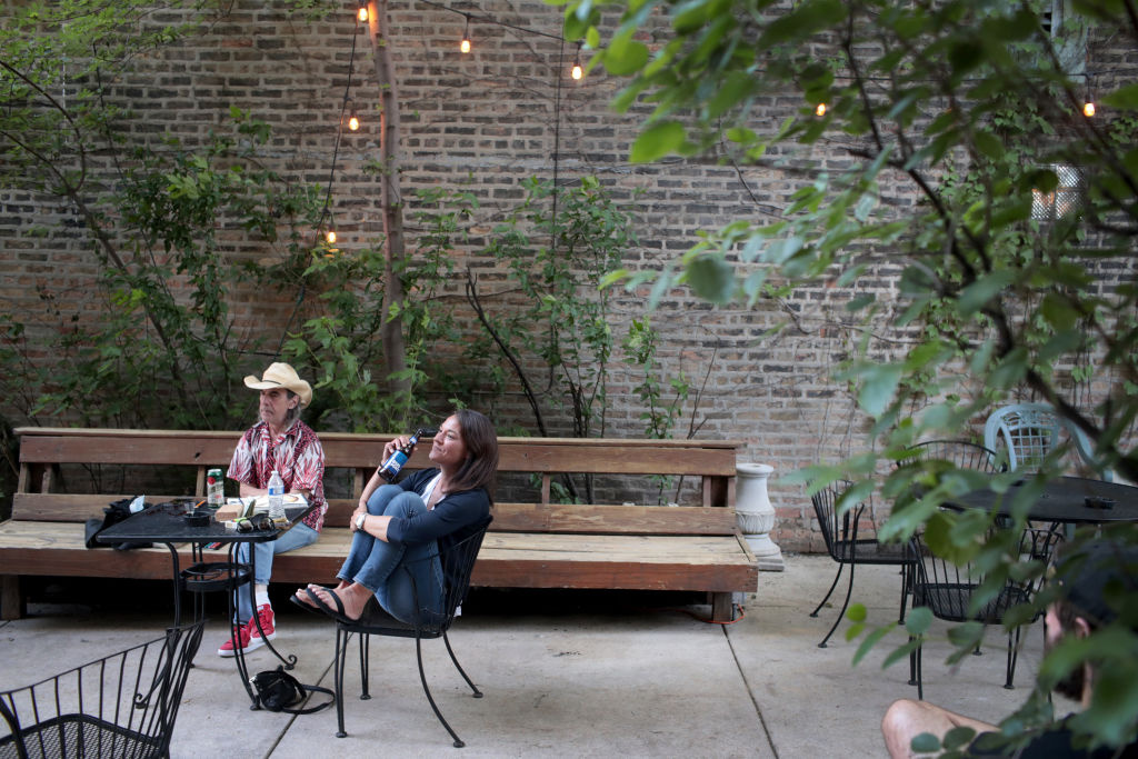 Patrons relax with a drink on the patio at Phyllis' Musical Inn on June 17, 2020 in Chicago, Illinois.