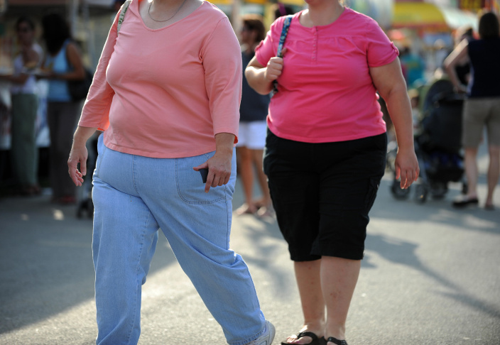 Two overweight women walk at the 61st Mo
