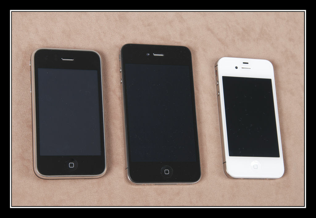 Three generations of iPhones side-by-side.