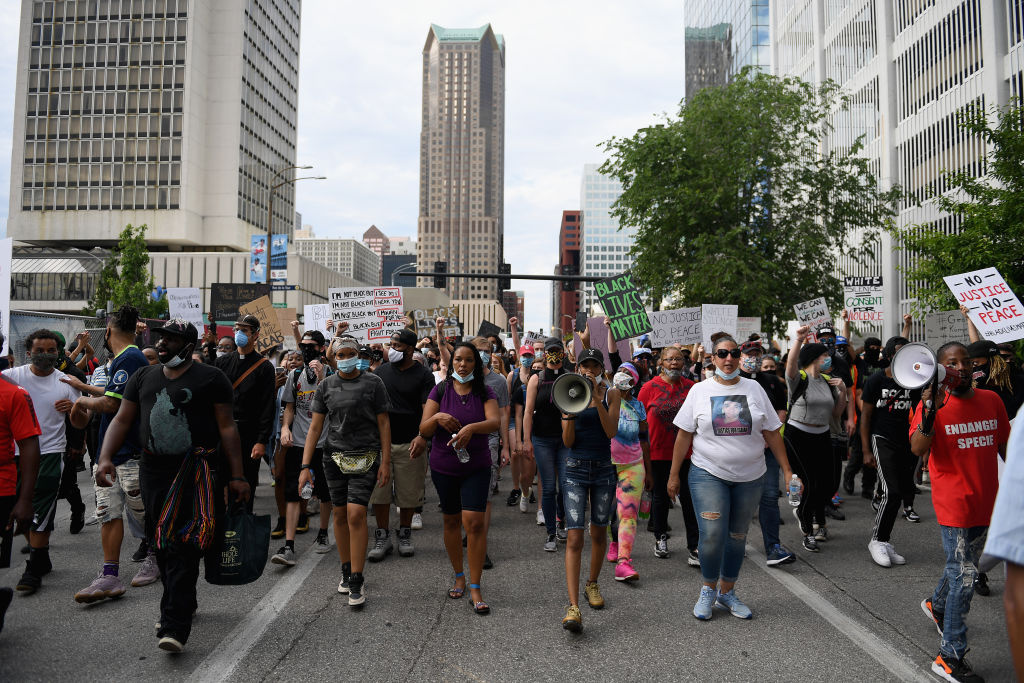 Protesters demonstrate against police brutality and the death of George Floyd through downtown St. Louis on June 1, 2020 in St Louis, Missouri.