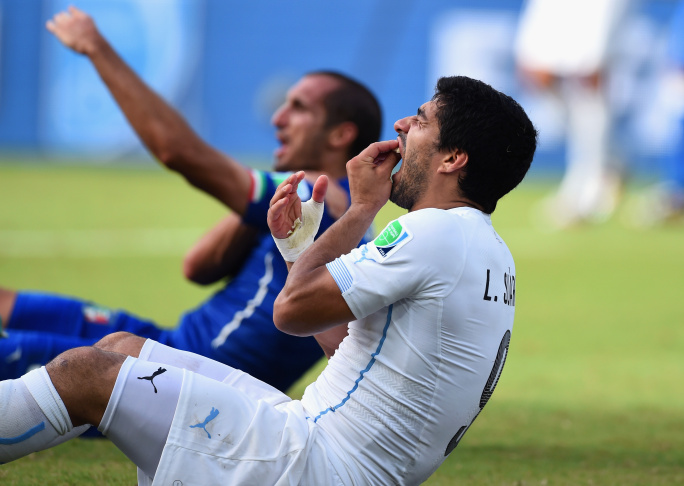 Uruguay star Luis Suarez faces expulsion from the World Cup for biting another player. Suarez, banned twice before for biting opponents, appeared to sink his teeth into defender Giorgio Chiellini during Uruguay's 1-0 win over Italy.