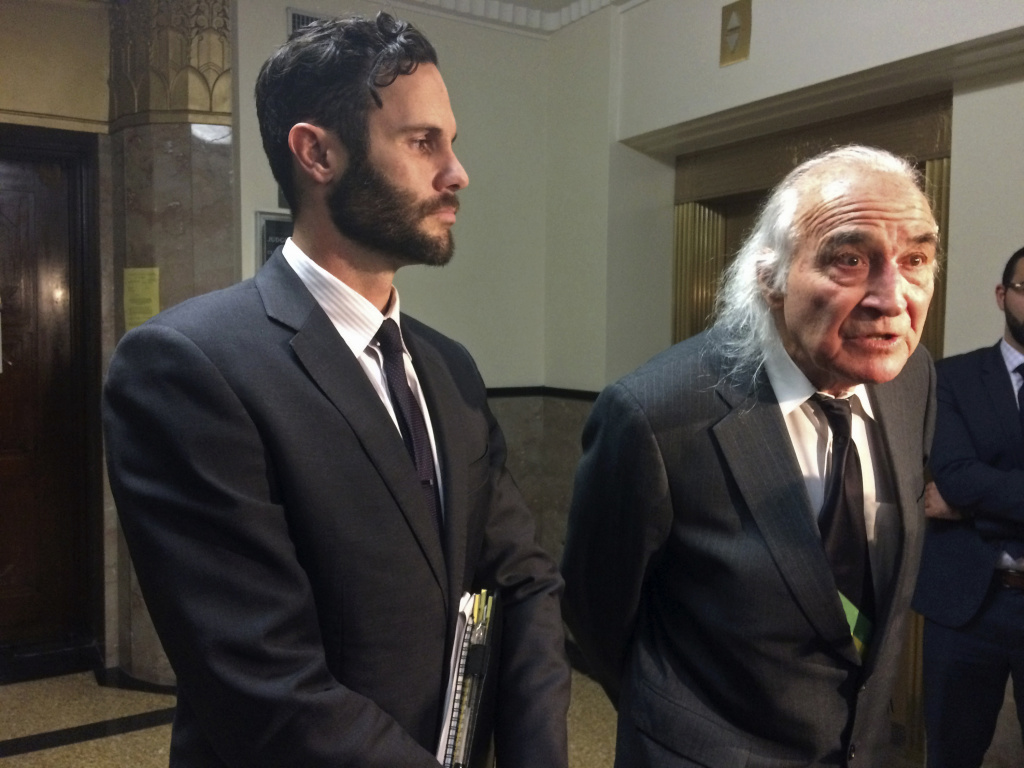 Attorneys Tyler Smith, left, and Tony Serra, right, representing defendants Max Harris and Derick Almena, who face involuntary manslaughter charges in the fire at the Oakland Ghost Ship warehouse last year, speak with reporters outside a courtroom Thursday, Dec. 14, 2017, in Oakland, Calif. A California city fire marshal said Thursday he did not find any records of requests by firefighters to inspect a warehouse where 36 people died in the worst building fire in the U.S. in more than a decade.