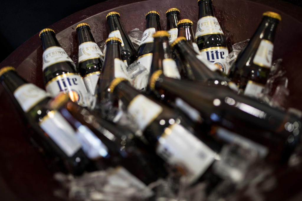 Miller Lite beer bottles sit on ice at a holiday party on December 14, 2017 in Trevose, Pennsylvania.