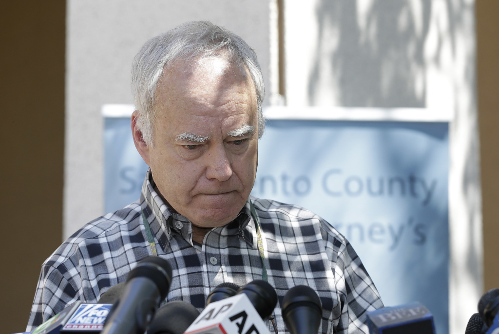 Bruce Harrington pauses as he discusses the arrest of Joseph James DeAngelo for a string of violent crimes in the 1970s and 1980s, including the murder of Harrington's brother and sister-in-law, at a news conference, Wednesday, April 25, 2018, in Sacramento.