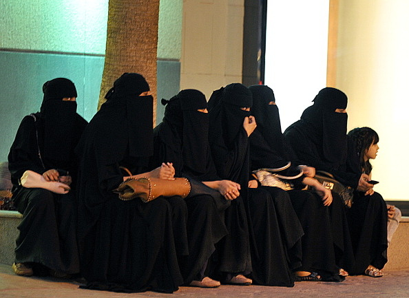 Saudi women wait for their drivers outside a shopping mall in Riyadh on September 26, 2011 a day after King Abdullah granted women the right to vote and run in municipal elections, in a historic first for the ultra-conservative country where women are subjected to many restrictions.