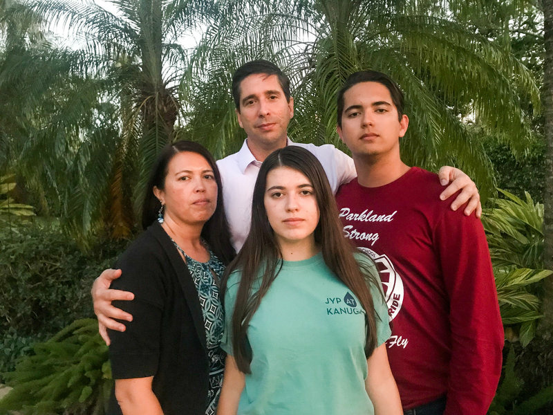 The Schentrup family stands for a group portrait outside their home in Parkland, Fla., on March 13, 2018.