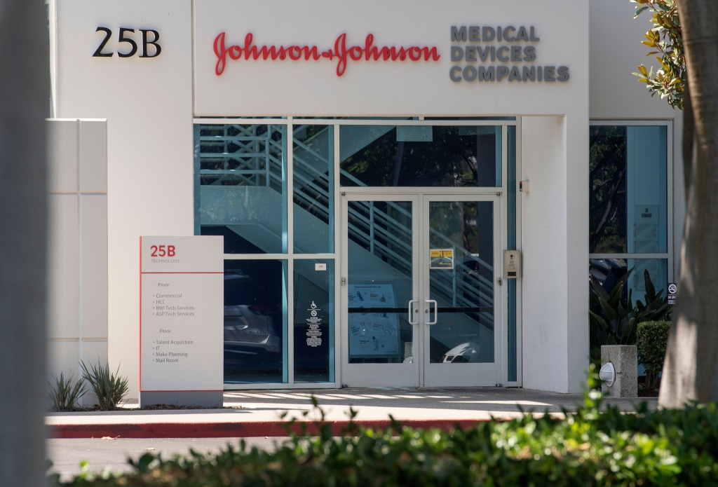The Johnson & Johnson logo is seen above an entrance to a building at their campus in Irvine, California.