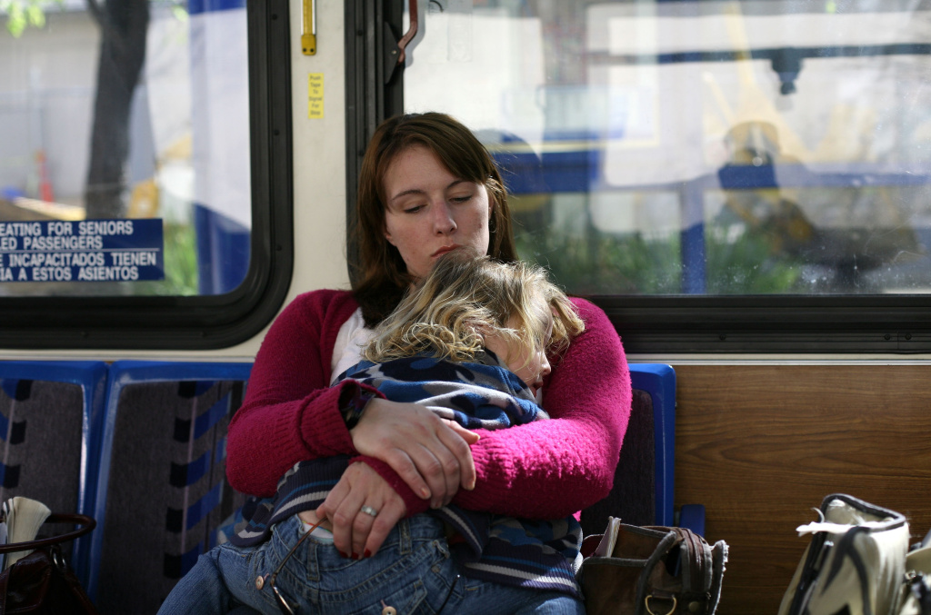 Brittney Nance holds her daughter Lillie, 2, as they ride the bus to an appointment March 6, 2009 in Sacramento, California.