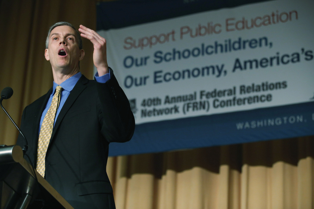 U.S. Education Secretary Arne Duncan addresses the National School Board Association's Federal Relations Nedtwork Conference at the Hilton Washington Hotel January 28, 2013 in Washington, DC. Duncan faced a number of questions from conference attendees on issues including the No Child Left Behind program. A new study concludes that state and district waivers to NCLB could allow millions of at-risk students to fall through the cracks.