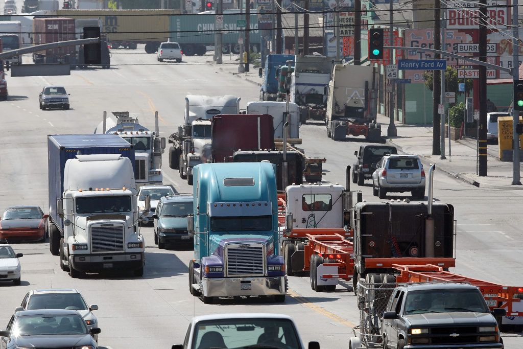 Trucks are driven near the Ports of Long Beach and Los Angeles, the busiest port complex in the US, on September near Long Beach, California.