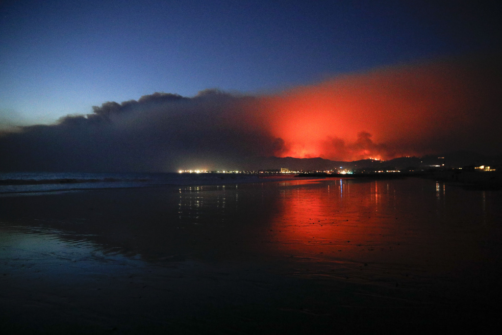 The glow of a wildfire as it burns in Ventura, California on Tuesday, Dec. 5, 2017. The Thomas Fire forced tens of thousands of people to evacuate their homes.