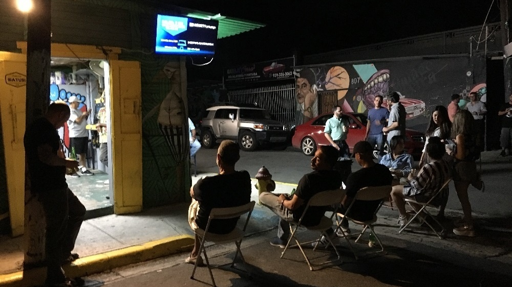 Puerto Ricans who could find a TV screen connected to a generator and a satellite link took advantage of the final game of the World Series to get a much needed diversion. Six weeks after Hurricane Maria, only about a third of the territory has power.