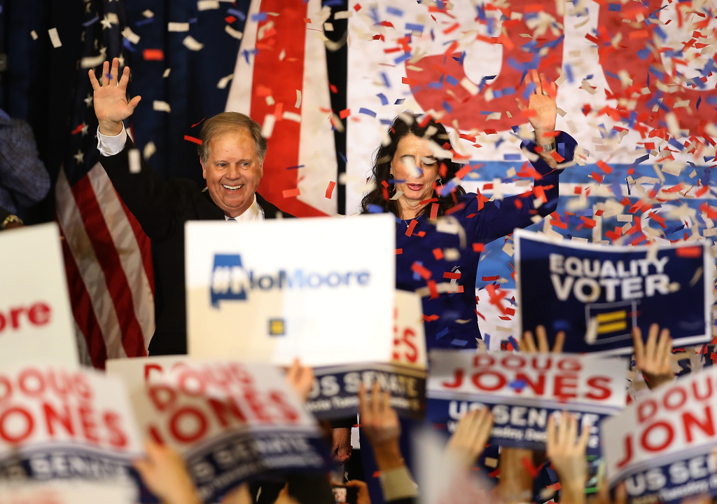 Democratic U.S. Senator elect Doug Jones (L) and wife Louise Jones (R) greet supporters during his election night gathering the Sheraton Hotel on December 12, 2017 in Birmingham, Alabama.