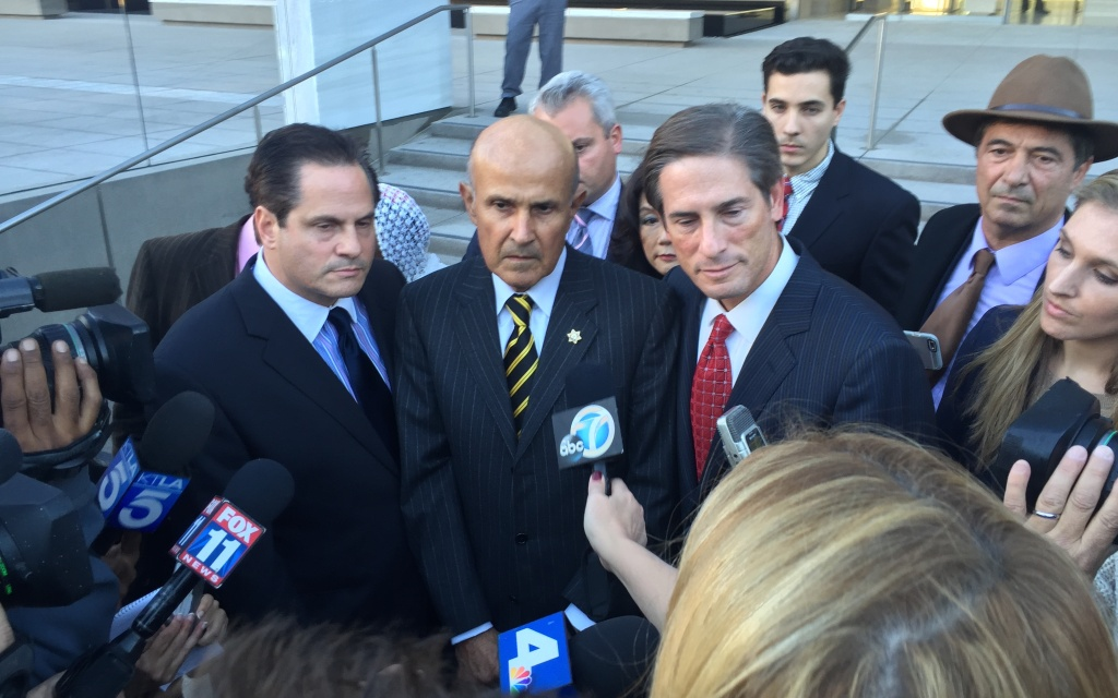 File: Baca (center) and his attorney Nathan Hochman (right) outside a federal court in Los Angeles after a judge declared a mistrial in the obstruction of justice case against him. He's now being retried.