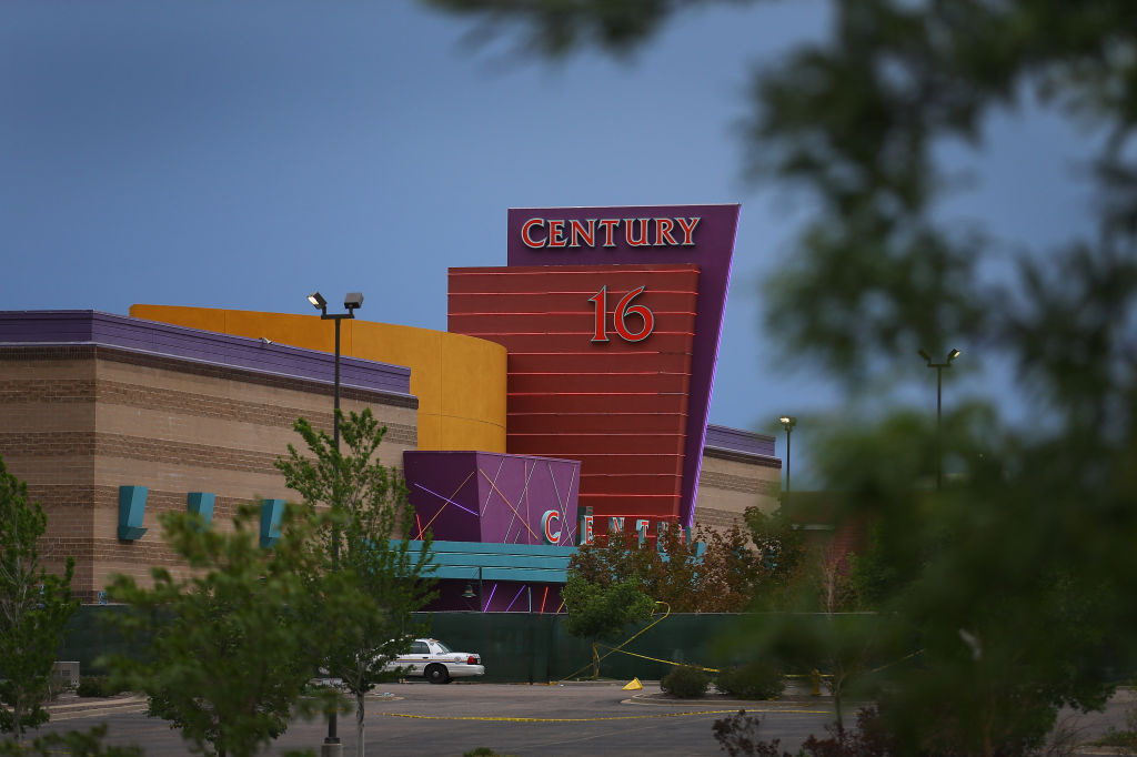 The Century 16 movie theatre is seen from a memorial setup across the street on July 28, in Aurora, Colorado.