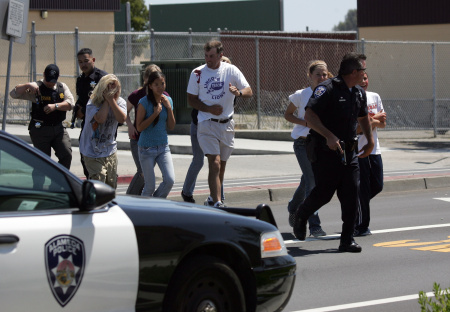 An Alameda Police officer evacuates volunteer students wearing makeup to simulate injuries during a school shooting and mass evacuation drill at Lincoln Middle School May 22, 2007 in Alameda, California