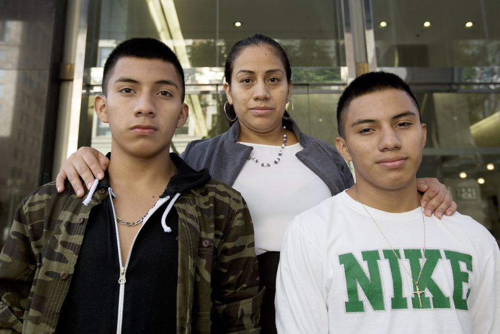 Ana Hernández with her sons Luis González, 16 and Alejandro González, 16 (white shirt) stand on the steps of L.A.'s immigration court in downtown just ahead of a court date for their younger sister Mariela Michell on Friday, August 12th, 2016.