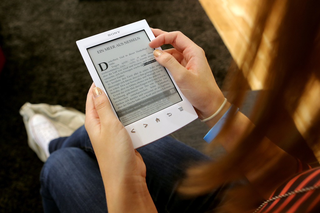 A young girl looks at a Sony e-book at the Frankfurt Book Fair on October 10, 2012 in Frankfurt, Germany. The Frankfurt Book Fair is the largest in the world and will run from October 10 - 14, 2012.