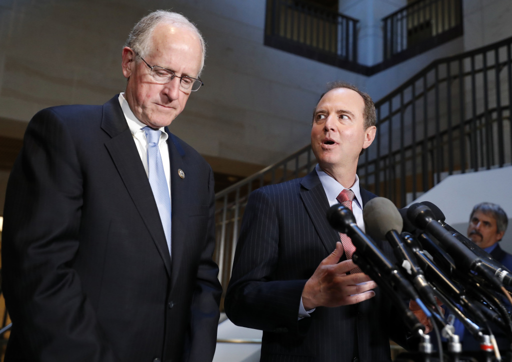 In this June 6, 2017, file photo Rep. Mike Conaway, R-Texas, left, a member of the House Intelligence Committee, and Rep. Adam Schiff, D-Calif., ranking member of the House Intelligence Committee speak after closed meeting in Washington. The Republican-led House intelligence committee on April 27, 2018, officially declared the end of its Russia probe, saying in its final report that it found no evidence that the Trump campaign colluded with Russia in the 2016 presidential campaign.