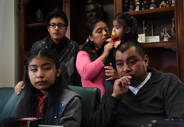 Immigrant Mario Vargas (C) waits with his wife Lola (L) and their daughter Athena in their attorney's office before his deportation hearing in Los Angeles, California on February 9, 2017. The family's plight has gained public attention after their daughter Jersey met with the Pope to discuss the possible deportation of Mario.