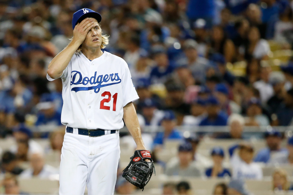 Zack Greinke #21 of the Los Angeles Dodgers reacts in the seventh inning against the New York Mets in game five of the National League Division Series at Dodger Stadium on October 15, 2015 in Los Angeles, California.