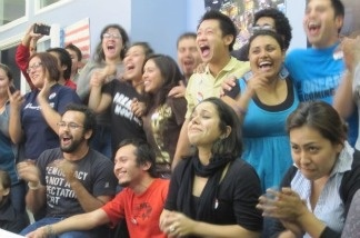 Students at the UCLA Downtown Labor Center in Los Angeles react to news of the Dream Act victory in the House on Dec. 8, 2010. Many had spent the day there calling legislators.