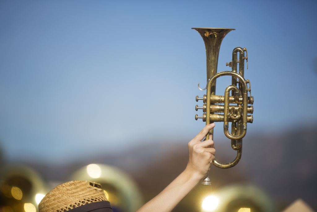 Junior Aidan Shirey, a member of the Temple City High School marching band, holds up his trumpet to help with choreography.