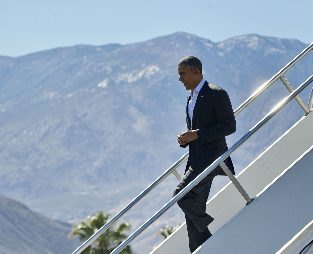 President Barack Obama walks down the stairs from Air Force One upon his arrival at Palm Springs International Airport on Feb. 12, 2016. Obama will be joined by Secretary of State John Kerry at the Sunnylands resort in Rancho Mirage for a gathering on Monday and Tuesday of the leaders of the Association of Southern Asian Nations (ASEAN). The summit is aimed at strengthening the U.S.- ASEAN strategic partnership.