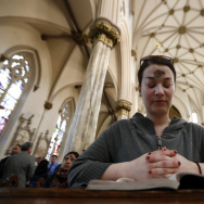 A woman prays after receiving the ashes during an Ash Wednesday service at St. Patrick's Pro-Cathedral, Wednesday, March 1, 2017, in Newark, N.J. (AP Photo/Julio Cortez)