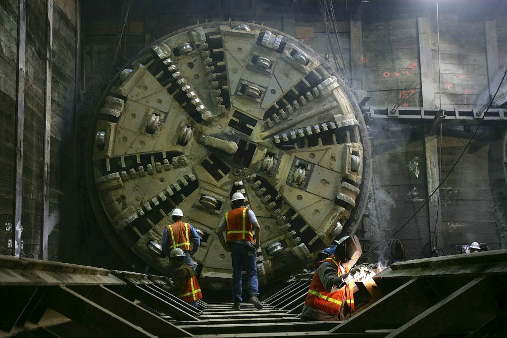 Workers put final touches to a support structure, as 'Lola', one of two massive Tunnel Boring Machines (TBM) creating tunnels for the Light Rail Eastside Extension, after it broke through from burrowing a 1.7-mile tunnel segment for the Metro Gold Line eastward on November 16, 2006 in Los Angeles, California.