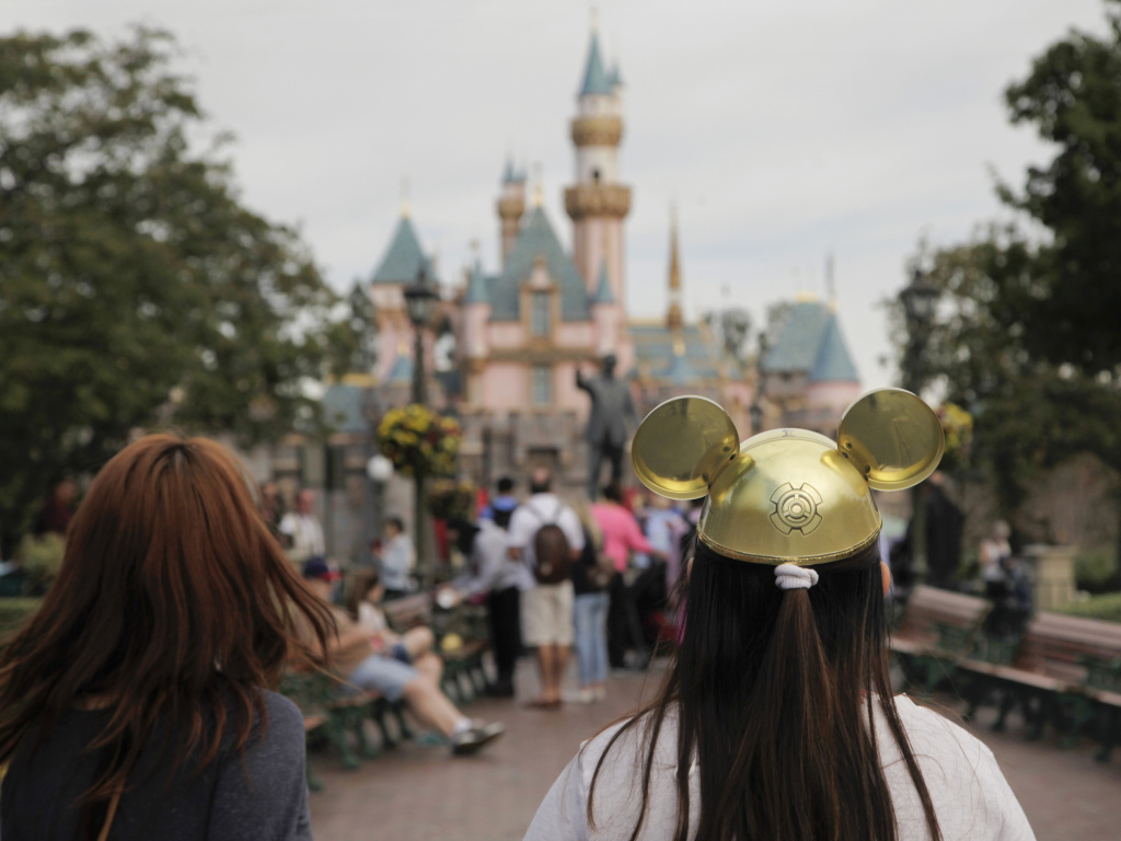 Social clubs have sprung up at Disneyland in Anaheim, Calif., in recent years — and a lawsuit describes threats of violence aimed at one of them.