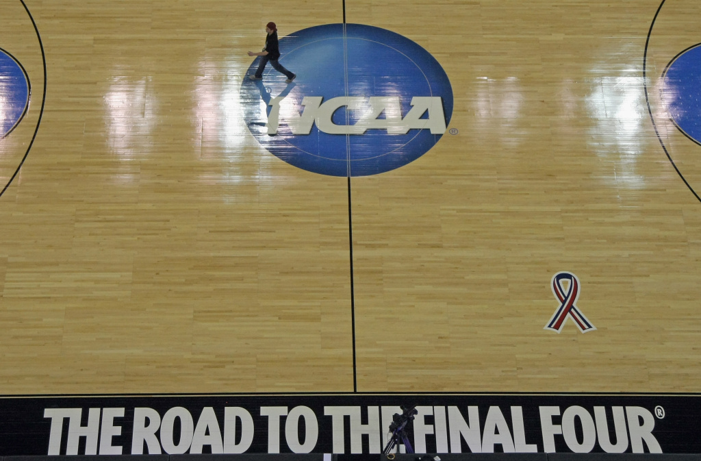 The court is prepared by the venue staff for the second round of the NCAA Men's Basketball Tournament at CenturyLink Center on March 15, 2012 in Omaha, Nebraska.