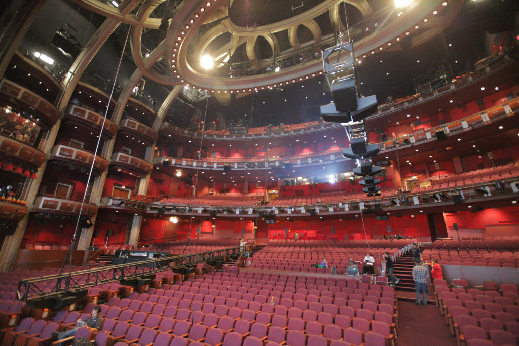 This  undated image released by Dolby Laboratories shows the interior of the new Dolby Theatre as two overhead speaker trusses are lifted into place in Los Angeles. The posh 3,400-seat Hollywood & Highland Center home of the Academy Awards is officially christened with a new name and a state-of-the-art audiovisual system that can project 3-D imagery and blast sound from multiple perspectives. (AP Photo/Dolby Laboratories)