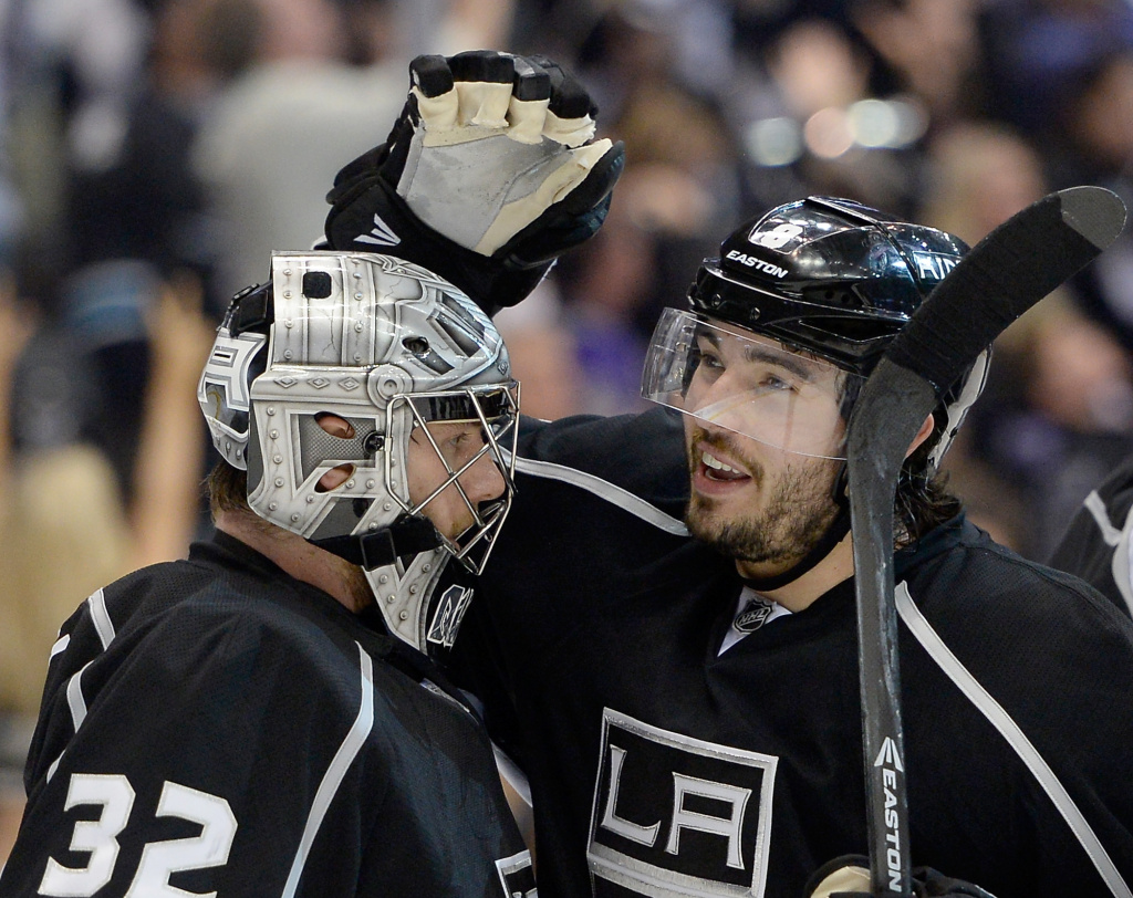 Drew Doughty #8 and Jonathan Quick #32 of the Los Angeles Kings