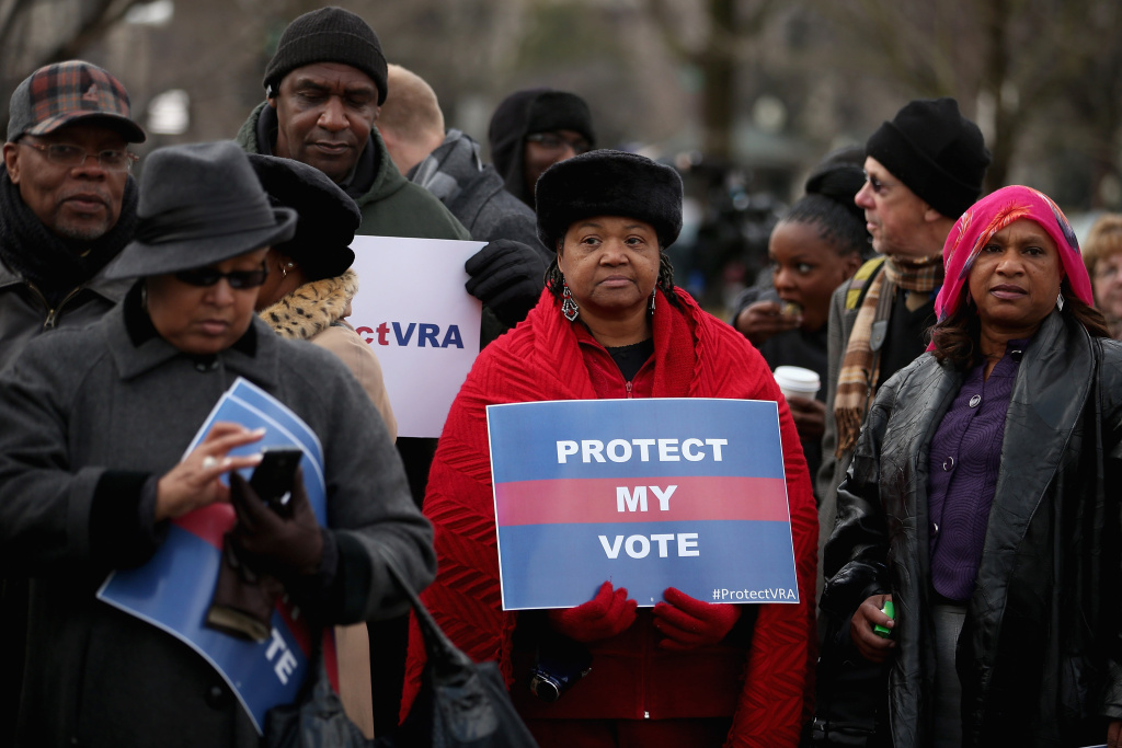 Residents from Alabama stand in line outside the U.S. Supreme Court for a chance to hear oral arguments February 27, 2013 in Washington, DC. The court will hear oral arguments today in Shelby County v. Holder, a legal challenge to Section 5 of the Voting Rights Act.