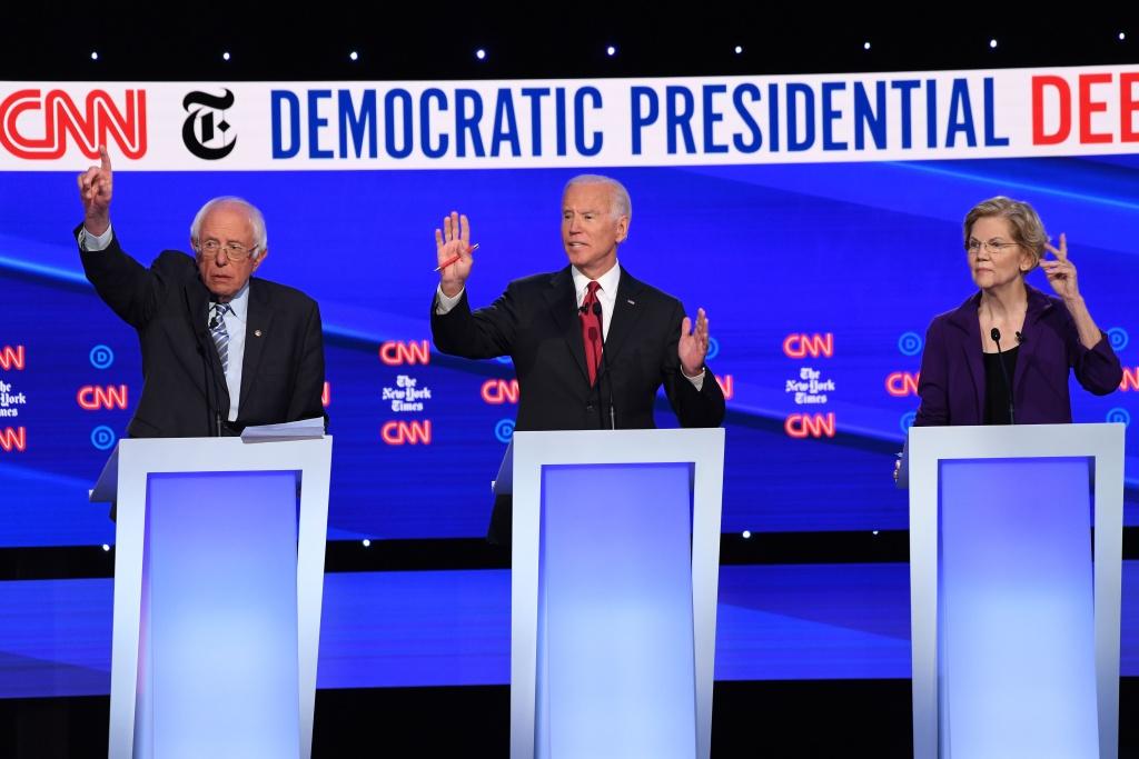 Democratic presidential hopefuls Vermont Senator Bernie Sanders (L), Former Vice President Joe Biden (C), and Massachusetts Senator Elizabeth Warren participate during the fourth Democratic primary debate on October 15, 2019.