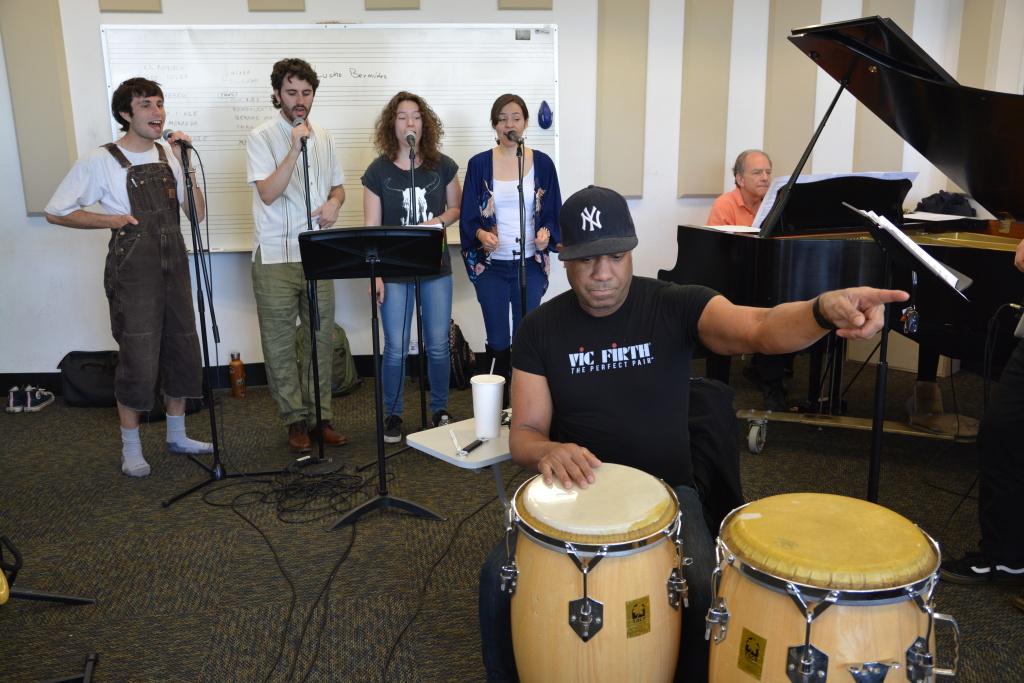 The CalArts Salsa Band singers in rehearsal. (L-R): Gabriel Stout, Pablo Leñero, Ewa Zmijewska and Tiffany Lantello. The ensemble is led by percussionist Joey de León and pianist David Roitstein.